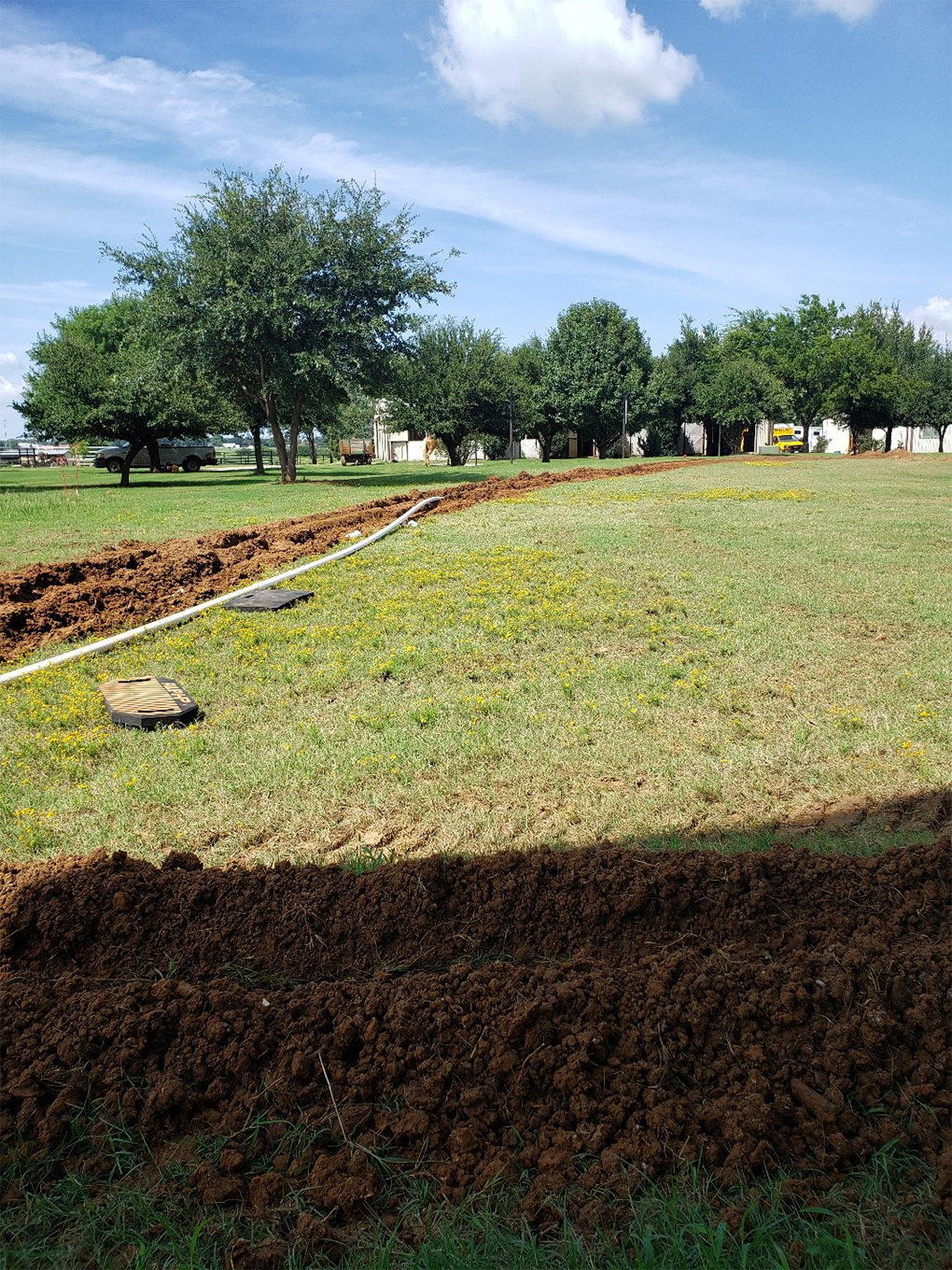 Photo of trench for a very long sewer line replacement